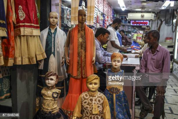 Mannequins sit on display outside a saree store in Varanasi Uttar Pradesh India on Saturday Oct 28 2017 In Varanasi where the manufacture of 45meter...