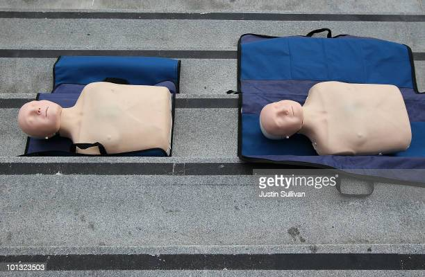 Mannequins sit on the steps of San Francisco city hall during a press conference celebrating the 50th anniversary of lifesaving by using C.P.R. June...