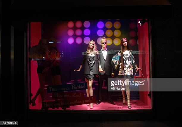 Mannequins stand in a display window at Bloomingdale's 59th Street to celebrate Barbie's 50th anniversary on February 12 2009 in New York City