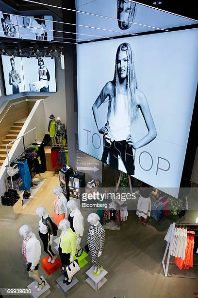 Mannequins stand in Arcadia Group Ltd.'s new Topshop store in Central district in Hong Kong, China, on Wednesday, June 5, 2013. Fashion chain...