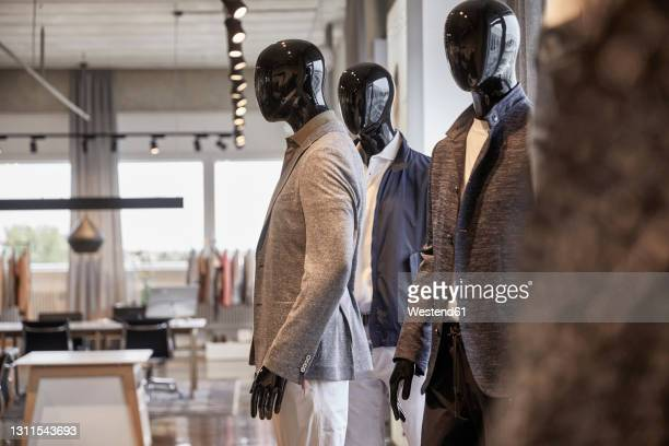 mannequins wearing business casuals at clothing design studio - male likeness stock pictures, royalty-free photos & images