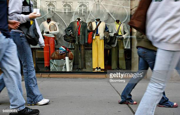 Mannequins wearing spring fashions stand in the front window of an Alfred Dunhil store in New York Tuesday April 3 2007 Warmer weather spurred a 49...