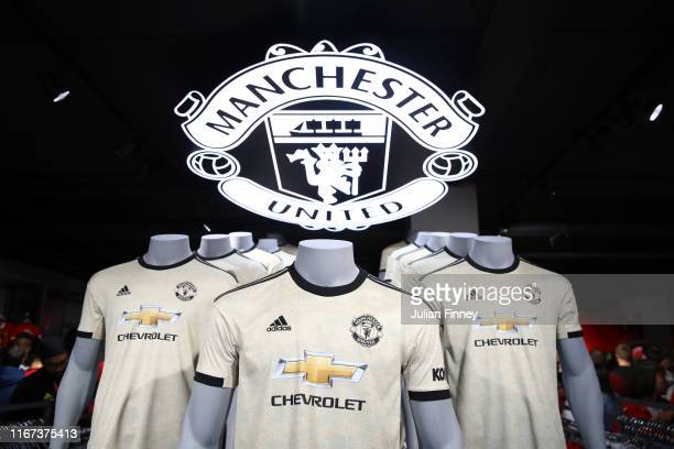Mannequins wearing the new Manchester United away kit are seen prior to the Premier League match between Manchester United and Chelsea FC at Old...