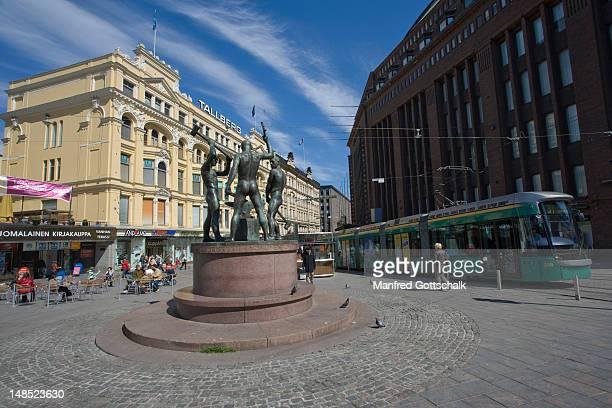 Mannerheimintie, The Three Smiths statue, by Felix Nylund at crossing point of Aleksanterkatu and Mannerheimintie.