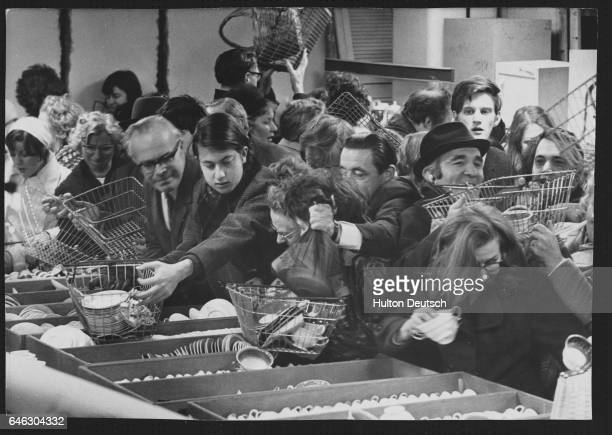Manners are cast aside as January sale shoppers jostle for space in the crockery department of Selfridge's store