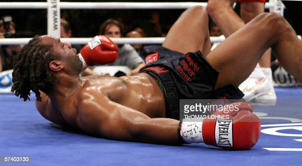 Heavyweight champion Chris Byrd is floored by Ukrainian heavyweight boxer Wladimir Klitschko during their title bout in Mannheim late 22 April 2006....