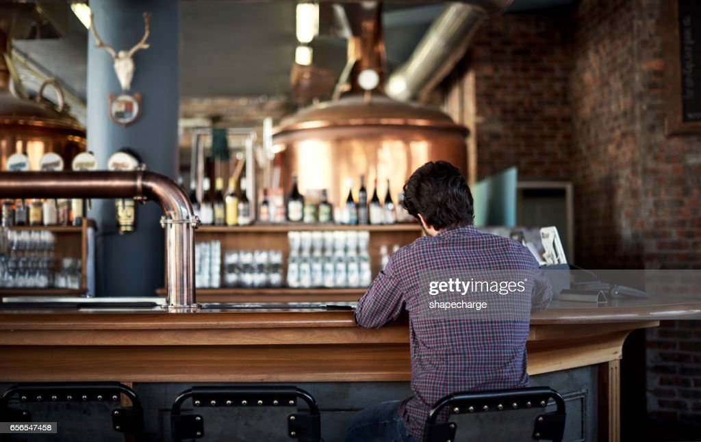 Manning the bar : Stock Photo