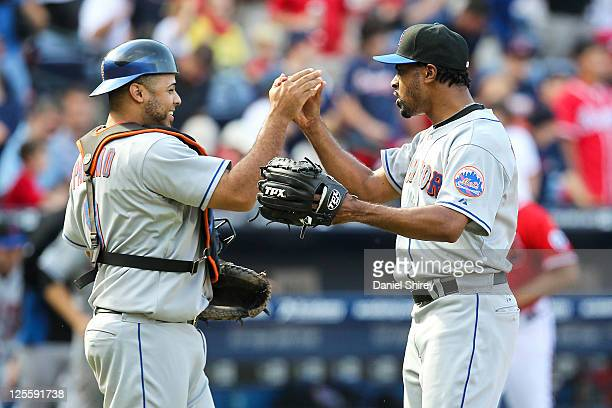 Manny Acosta of the New York Mets celebrates with Ronny Paulino after getting the save in the ninth inning of the game against the Atlanta Braves at...
