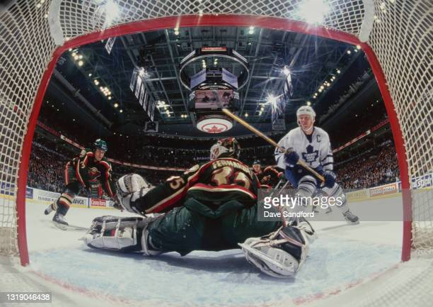 Manny Fernandez, Goalkeeper for the Minnesota Wild saves the shot from Mats Sundin, Captain and Center for the Toronto Maple Leafs during the NHL...