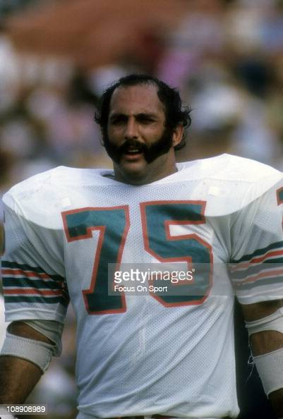 Manny Fernandez Of The Miami Dolphins Looks On From The
