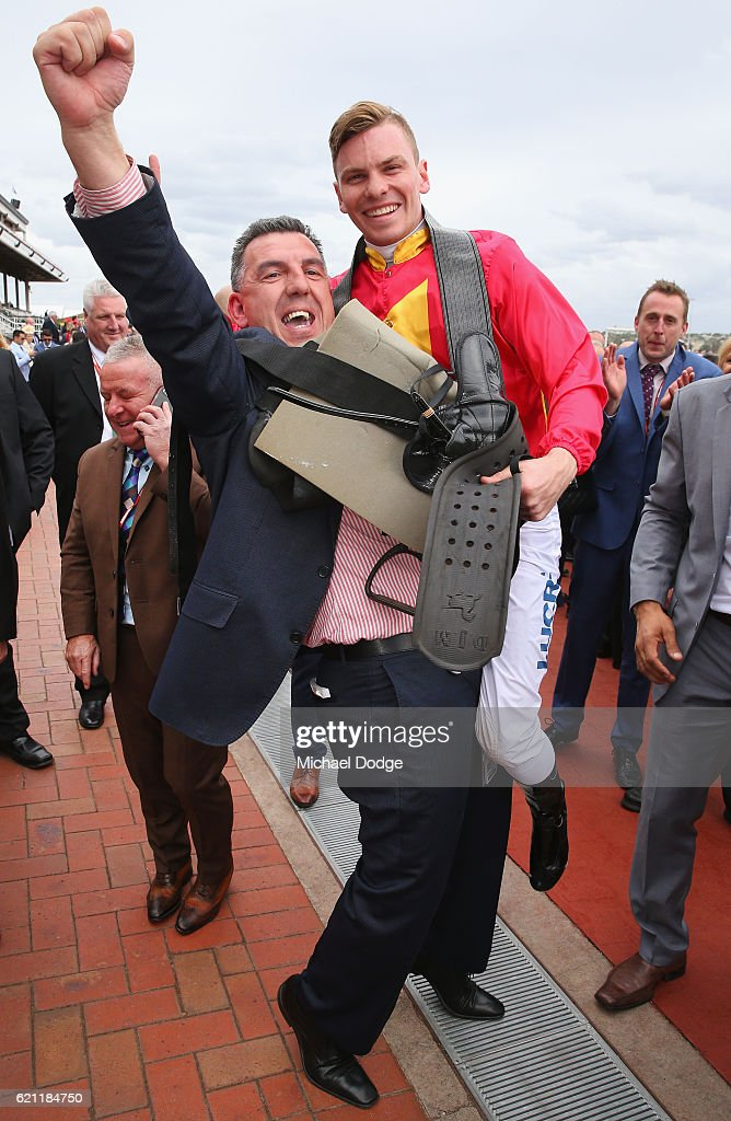 Manny Gelagotis, brother of trainer Peter Gelagotis, celebrates with Jockey Ben Melham after they won with Malaguerra in race 8 the Darley Classic on Stakes Day at Flemington Racecourse on November 5, 2016 in Melbourne, Australia.