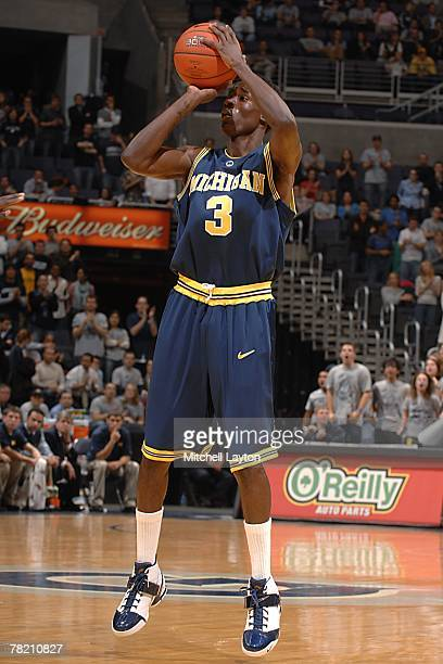 Manny Harris of the Michigan Wolverines looks for the shot during the college basketball game against the Georgetown Hoyas at the Verizon Center on...