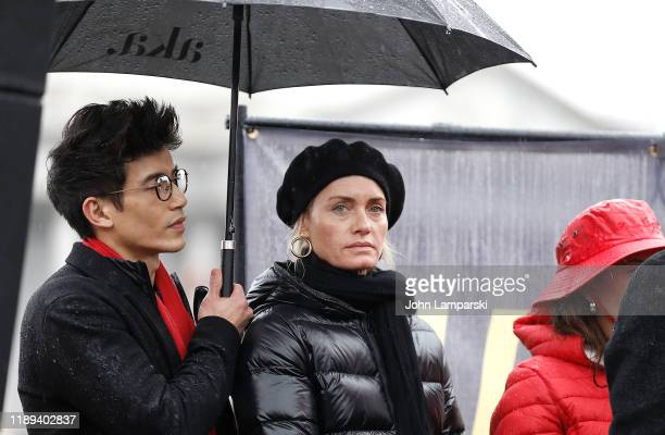 Manny Jacinto and Amber Valletta demonstrate near the US Capitol during Fire Drill Friday climate change protest on November 22 2019 in Washington DC...