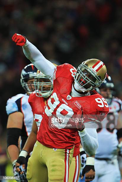 Manny Lawson of San Francisco 49ers celebrates as he sacks Kyle Orton of Denver Broncos during the NFL International Series match between Denver...