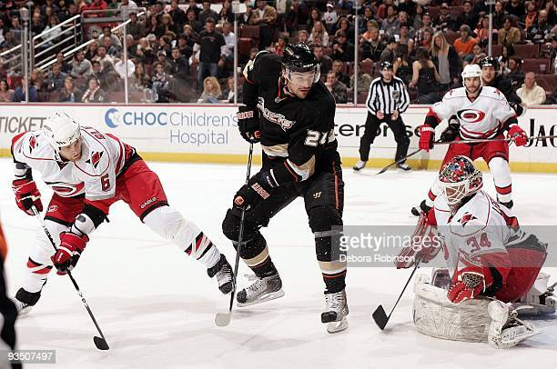 Manny Legace of the Carolina Hurricanes defends the crease against Evgeny Artyukhin of the Anaheim Ducks during the game on November 25 2009 at Honda...
