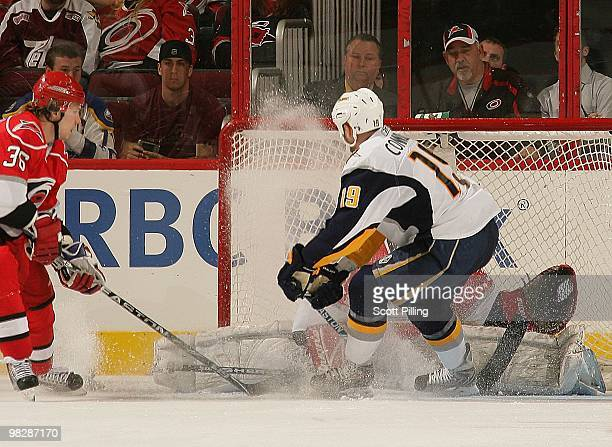 Manny Legace of the Carolina Hurricanes drops down to stop a shot on goal by Tim Connolly of the Buffalo Sabres during the NHL game on March 21 2010...
