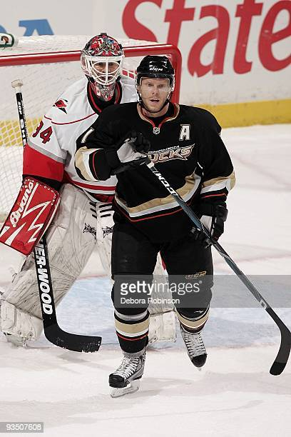 Manny Legace of the Carolina Hurricanes stands in the crease defending against Saku Koivu of the Anaheim Ducks during the game on November 25 2009 at...