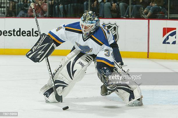 Manny Legace of the St. Louis Blues gathers the puck against the Nashville Predators at Gaylord Entertainment Center on January 6, 2007 in Nashville,...