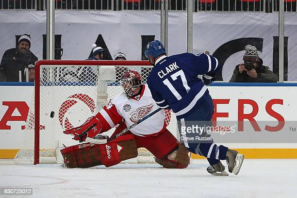 TORONTO ON DECEMBER 31 Manny Legace would stop this breakaway shot by Wendel Clark but Clark would score on the rebound as the Toronto Maple Leafs...