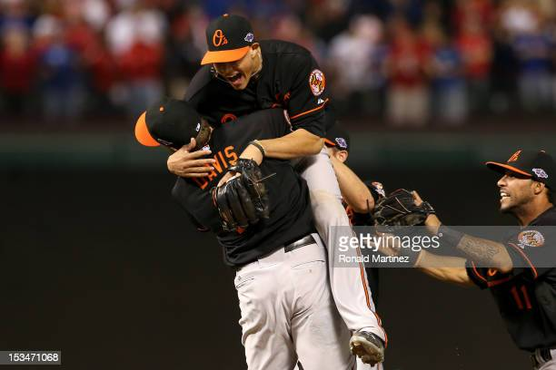 Manny Machado and Chris Davis of the Baltimore Orioles celebrate after they won 5-1 against the Texas Rangers during the American League Wild Card...