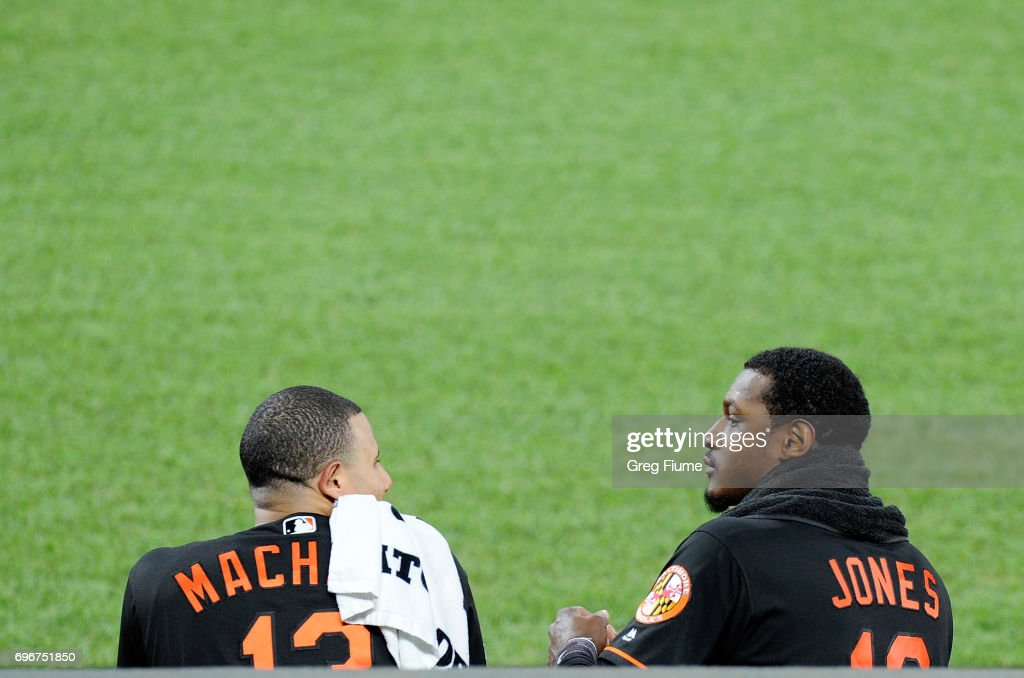 Manny Machado #13 and Adam Jones #10 of the Baltimore Orioles talk during the fifth inning against the St. Louis Cardinals at Oriole Park at Camden Yards on June 16, 2017 in Baltimore, Maryland.