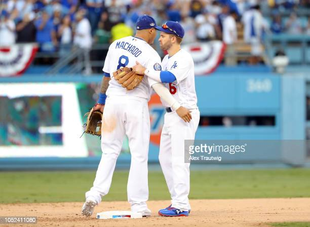 Manny Machado and Brian Dozier of the Los Angeles Dodgers celebrate after winning Game 5 of the NLCS against the Milwaukee Brewers at Dodger Stadium...
