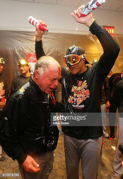 Manny Machado and Buck Showalter of the Baltimore Orioles celebrates after defeating the New York Yankees to clinch AL Wild Card spot at Yankee...