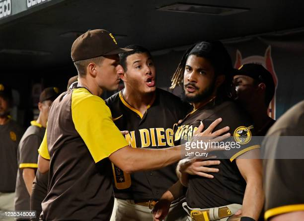 Manny Machado and Fernando Tatis Jr. #23 of the San Diego Padres exchange words in the dugout during the fifth inning against the St. Louis Cardinals...