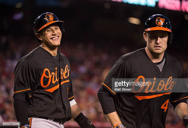 Manny Machado and Mark Trumbo of the Baltimore Orioles celebrate after scoring on Trumbo's tworun home run during the third inning of the game...