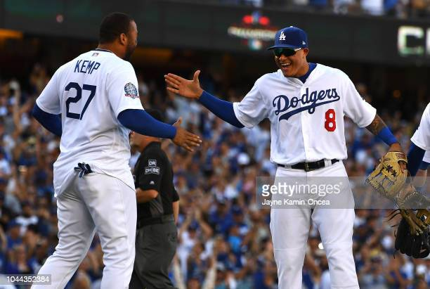 Manny Machado and Matt Kemp of the Los Angeles Dodgers celebrate after defeating the Colorado Rockies 62 to win the National League Western Division...