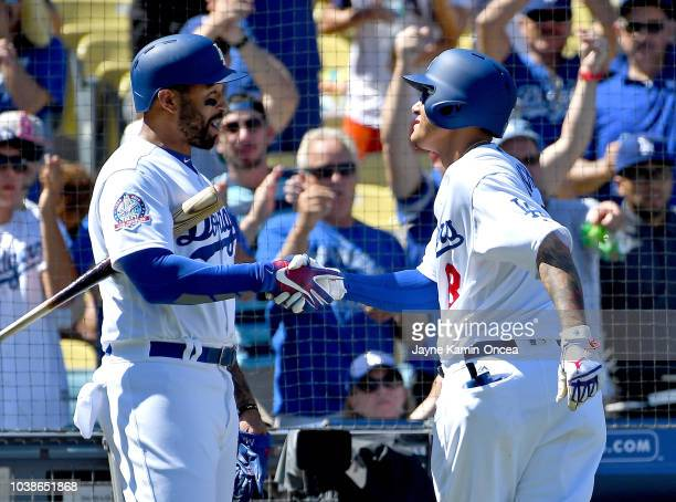 Austin Barnes is greeted by Matt Kemp of the Los Angeles Dodgers as he crosses the plate after hitting a two run home run in the fourth inning...