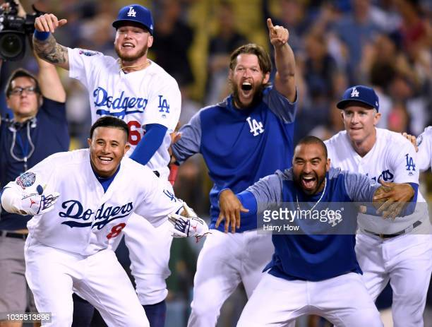 Manny Machado Matt Kemp Alex Verdugo Clayton Kershaw and Chase Utley of the Los Angeles Dodgers celebrate while waiting for Chris Taylor at home...