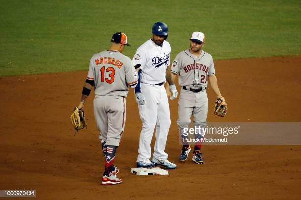 Manny Machado of the Baltimore Orioles and the American League and Jose Altuve of the Houston Astros and the American League speak to Matt Kemp of...