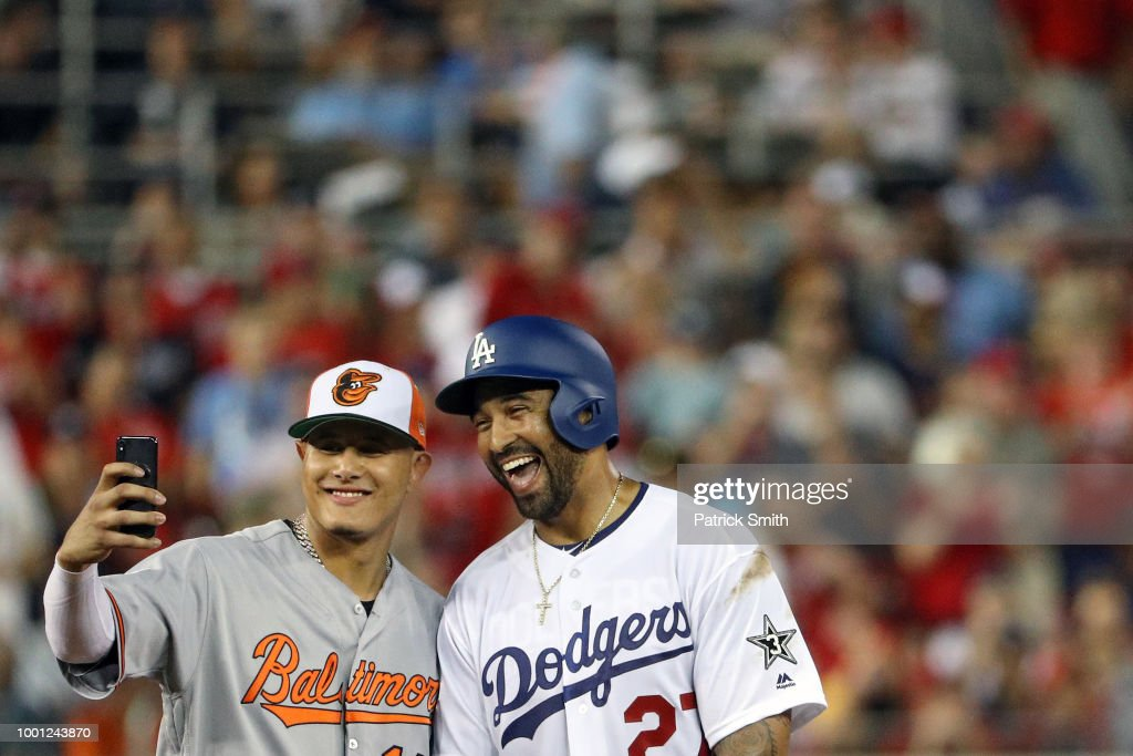 Manny Machado #13 of the Baltimore Orioles and the American League and Matt Kemp #27 of the Los Angeles Dodgers and the National League pose for a selfie in the second inning during the 89th MLB All-Star Game, presented by Mastercard at Nationals Park on July 17, 2018 in Washington, DC.