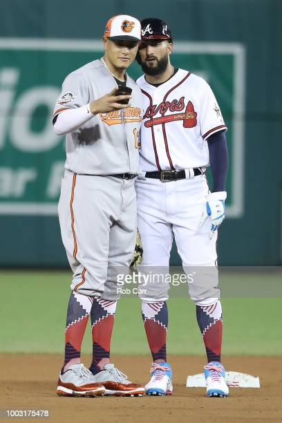 Manny Machado of the Baltimore Orioles and the American League takes a selfie with Nick Markakis of the Atlanta Braves and the National League during...