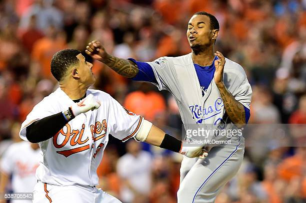 Manny Machado of the Baltimore Orioles and Yordano Ventura of the Kansas City Royals fight in the fifth inning during a MLB baseball game at Oriole...