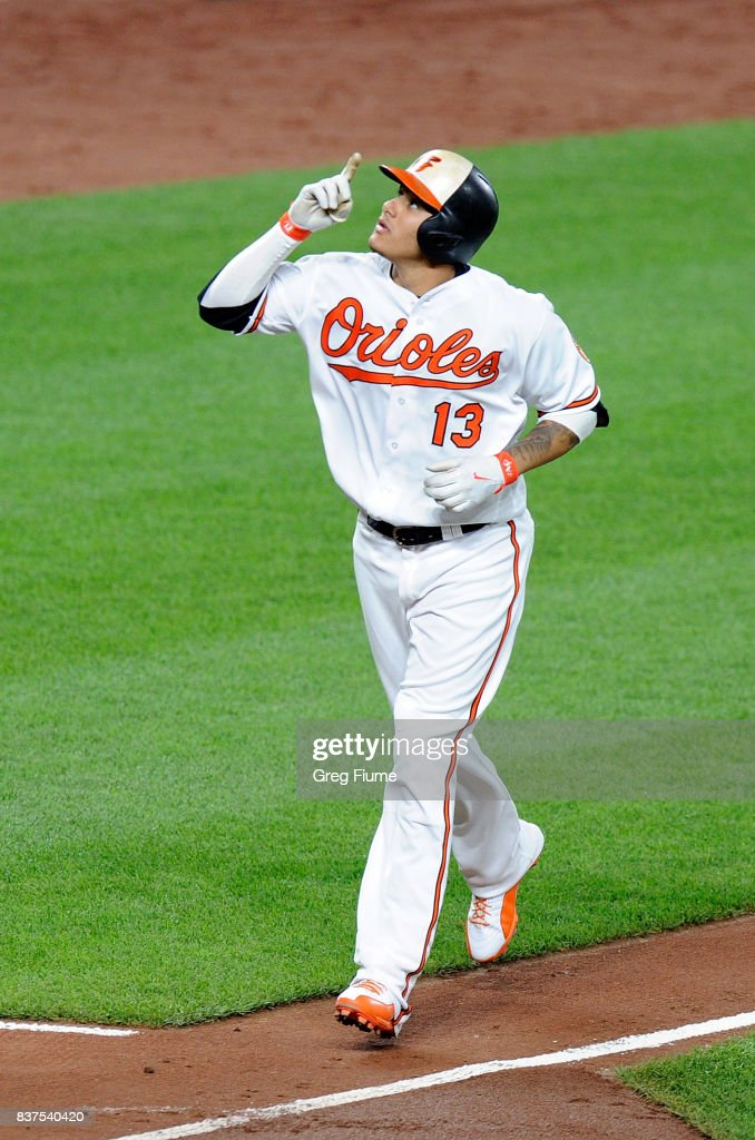 Manny Machado #13 of the Baltimore Orioles celebrates after hitting a two-run home run in the sixth inning against the Oakland Athletics at Oriole Park at Camden Yards on August 22, 2017 in Baltimore, Maryland.