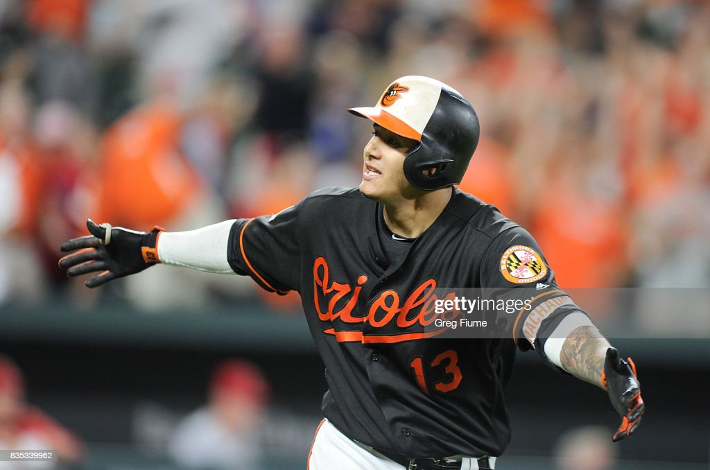 Manny Machado #13 of the Baltimore Orioles celebrates after hitting the game winning grand slam in the ninth inning against the Los Angeles Angels at Oriole Park at Camden Yards on August 18, 2017 in Baltimore, Maryland. Baltimore won the game 9-7.