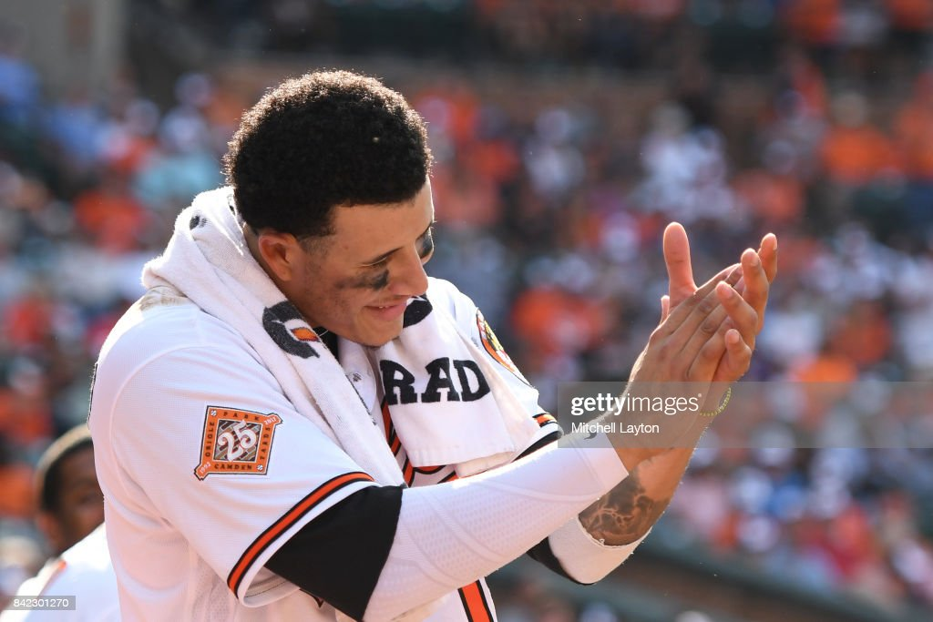 Manny Machado #13 of the Baltimore Orioles celebrates Jonathan Schoop #6 (not pictured) single in the 12th inning during a baseball game against the Toronto Blue Jays at Oriole Park at Camden Yards on September 3, 2017 in Baltimore, Maryland.
