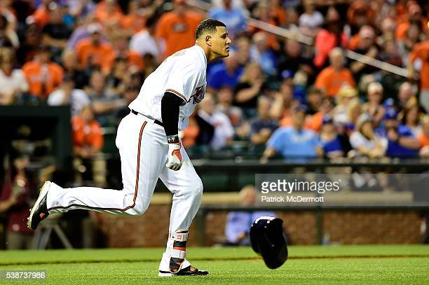 Manny Machado of the Baltimore Orioles charges the mound after being hit by a pitch thrown by Yordano Ventura of the Kansas City Royals in the fifth...