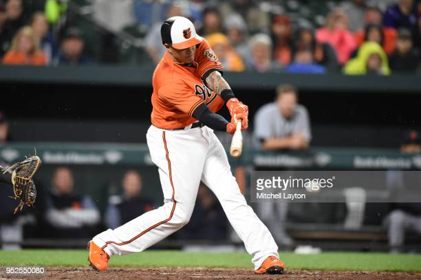 Manny Machado of the Baltimore Orioles doubles in two runs in the seventh inning during a baseball game against the Detroit Tigers at Oriole Park at...