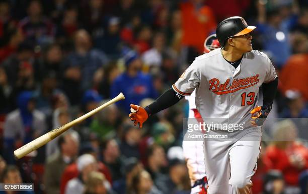 Manny Machado of the Baltimore Orioles drops his bat after hitting a solo home run in the sixth inning of a game against the Boston Red Sox at Fenway...