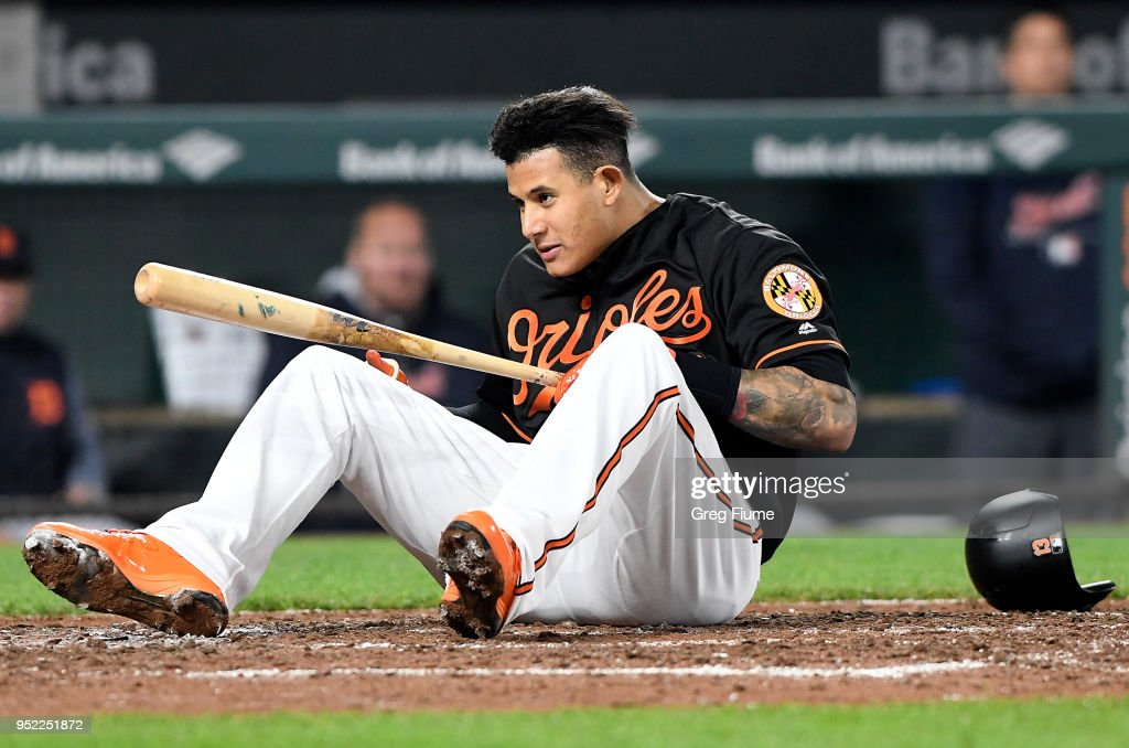 Manny Machado #13 of the Baltimore Orioles falls to the ground after avoiding a pitch in the eighth inning against the Detroit Tigers at Oriole Park at Camden Yards on April 27, 2018 in Baltimore, Maryland.