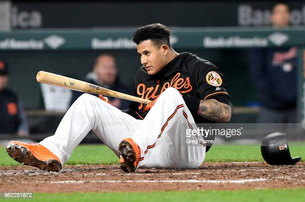 Manny Machado of the Baltimore Orioles falls to the ground after avoiding a pitch in the eighth inning against the Detroit Tigers at Oriole Park at...