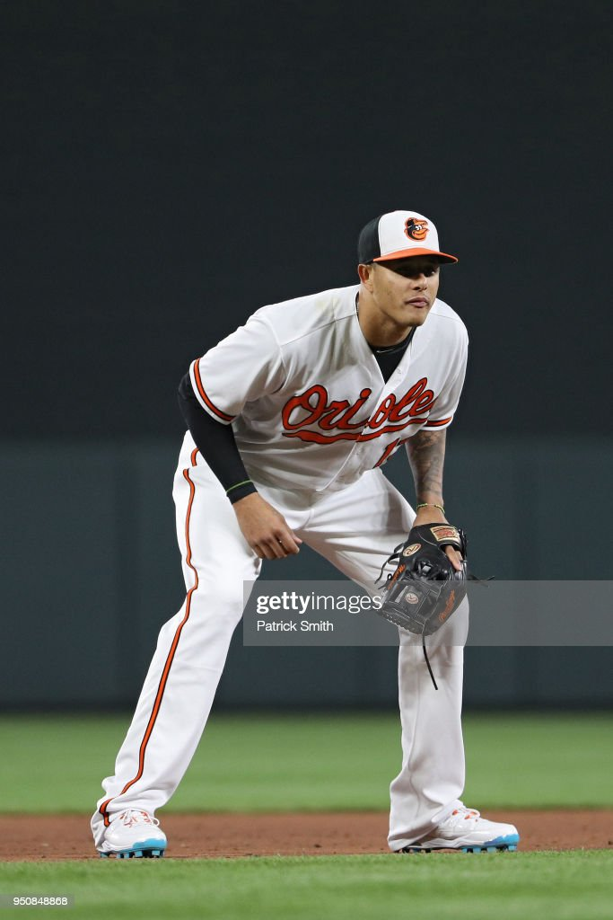 Manny Machado #13 of the Baltimore Orioles fields against the Cleveland Indians at Oriole Park at Camden Yards on April 23, 2018 in Baltimore, Maryland.