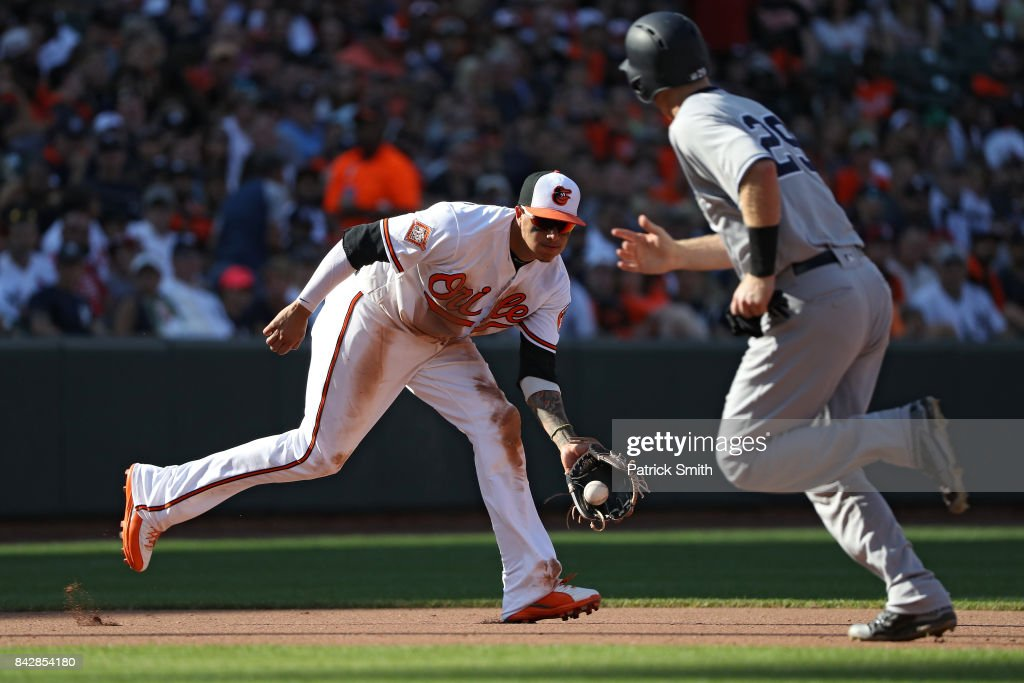 Manny Machado #13 of the Baltimore Orioles fields against the New York Yankees at Oriole Park at Camden Yards on September 4, 2017 in Baltimore, Maryland.