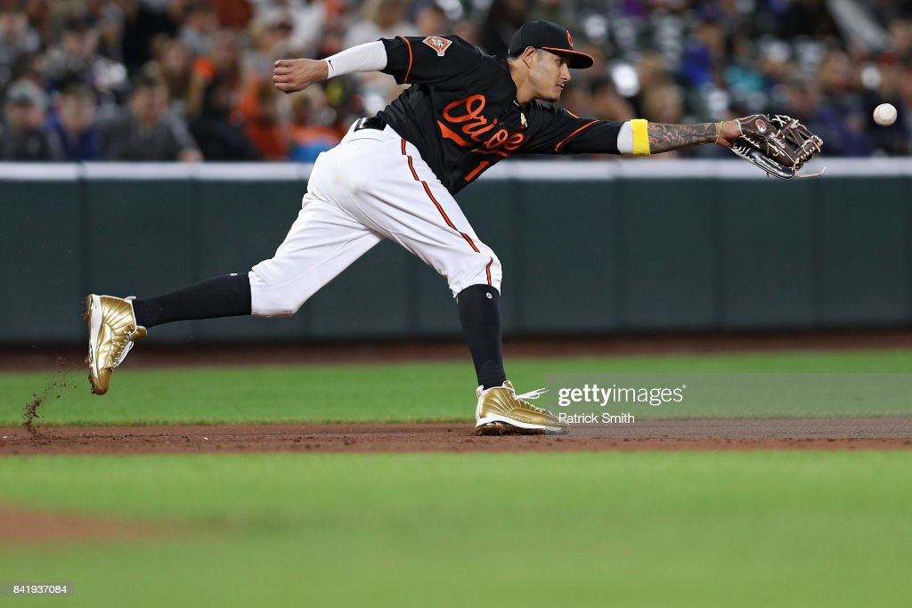 Manny Machado #13 of the Baltimore Orioles fields against the Toronto Blue Jays at Oriole Park at Camden Yards on September 1, 2017 in Baltimore, Maryland.