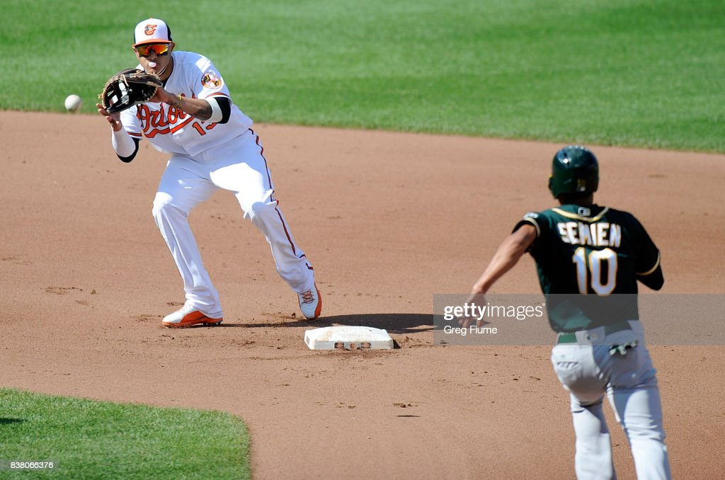 Manny Machado #13 of the Baltimore Orioles forces out Marcus Semien #10 of the Oakland Athletics at second base in the fourth inning at Oriole Park at Camden Yards on August 23, 2017 in Baltimore, Maryland.