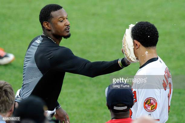 Manny Machado of the Baltimore Orioles gets pied by Adam Jones after hitting the game-winning home run in the 12th inning against the Oakland...