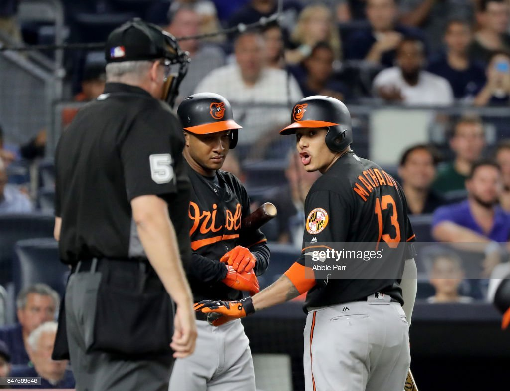 Manny Machado #13 of the Baltimore Orioles has words with home plate umpire Paul Emmel #50 after he strikes out in the first inning against the New York Yankees on September 15, 2017 at Yankee Stadium in the Bronx borough of New York City.